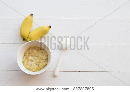 Mashed Banana Healthy Foods For Baby On Background White Wooden