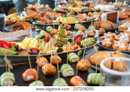 A lot of various food on catering table, self service restaurant or hotel breakfast