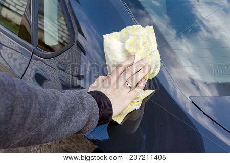 Hand Washing Car Wash. The Hand Holds A Rag.