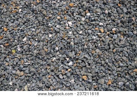 Grey Gravel Pile Closeup Photo For Background. Sharp Gray Stones In Pile For Construction. Road Or B