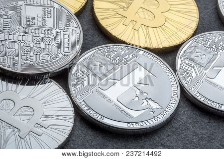 Bitcoin And Litecoin Over Lark Background. Cryptocurrency Trading Concept.