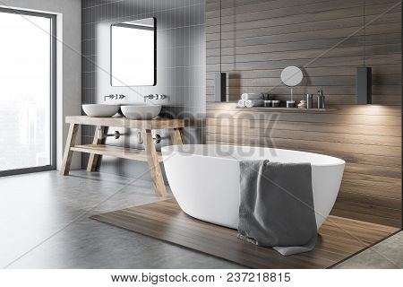 Black And Wooden Wall Bathroom Corner With A Tub And A Make Up Shelf. A Double Sink Near A Gray Wall
