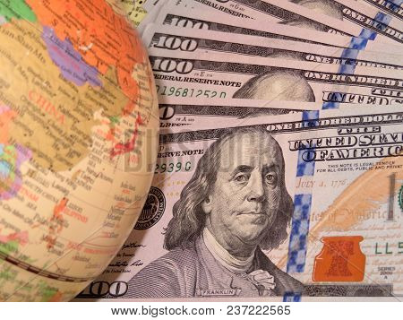 Us Dollars And Globe With China Map. A Trade War Between China And The United States