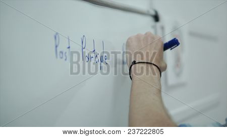 Smart Man Writing On Whiteboard. Clip. Close Up Of Man Writes The Writing On Board.