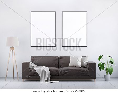 Modern Vintage Living Room. Brown Leather Sofa On A Grey Wooden Floor And Light Wall. Green Plant An