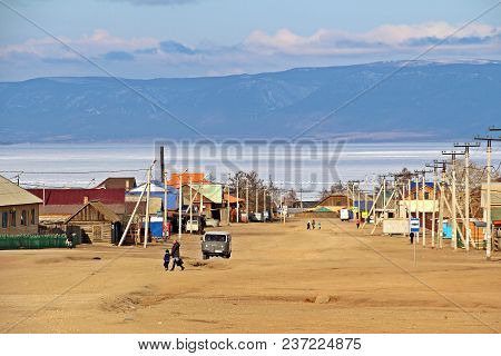 Looking Khuzhir City On Olkhon Island With Mountainous Behind Baikal Lake In Late Winter