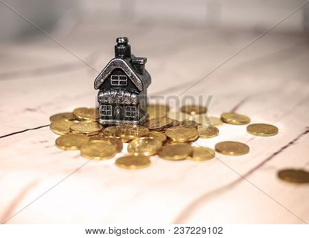 The House Stands On A Pile Of Coins, The Concept Of Cash Savings, Loans..