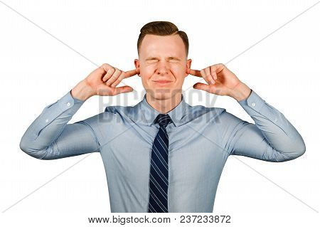 Young Businessman Dressed In Blue Shirt And Tie Closing His Ears And Eyes, Isolated On White Backgro