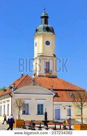 Bialystok, Poland - April 30, 2012: Town Hall Tower Over Red Tile Roof On Central Square Of Kosciusk