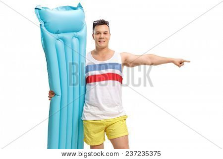 Tourist with an air matress pointing isolated on white background