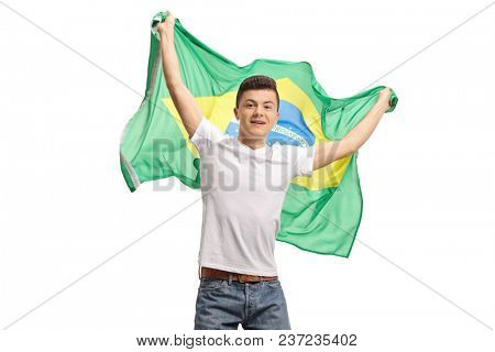 Excited teenage boy holding a Brazilian flag isolated on white background
