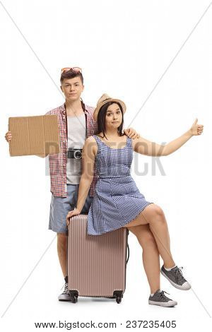 Sad teenage tourists with a blank cardboard sign hitchhiking isolated on white background