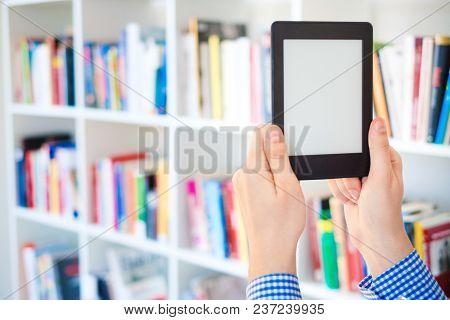 Hands Holding Ebook On Bookshelf Background.copy Space On Digital Tablet Display