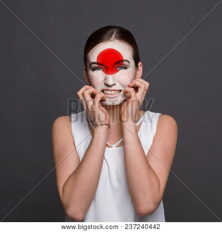Face Of Young Desperate Woman Painted With Flag Of Japan. Football Or Soccer Team Fan, Sport Event,