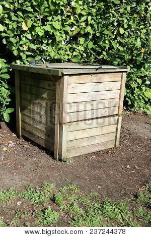 Wood Compost Bin In Family Garden Home