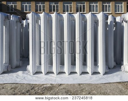 White Heating Radiator In Public Place.  Building. Repairs