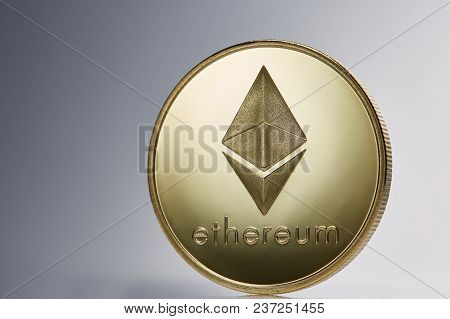 Golden Ethereum Coin. Crypto Currency Blockchain Coin Ethereum Symbol On Light Background, Close-up,