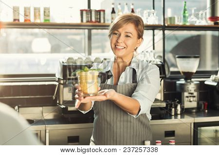 Experienced Middle Aged Barista Giving Tasty Cold Coffee Non-alcoholic Cocktail To Customer. Bartend