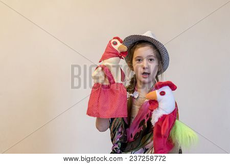 Girl 8 Years Playing In The Puppet Theater. Against A Light Background. Copy Space.