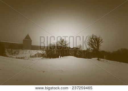 A Fortress Wall Of Smolensk In The Winter Fog. Wall Of Winter In The Background In The Fog. The Hill