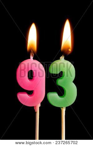 Burning Candles In The Form Of 93 Ninety Three (numbers, Dates) For Cake Isolated On Black Backgroun