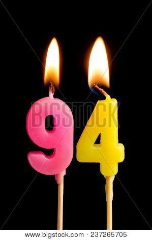 Burning Candles In The Form Of 94 Ninety Four (numbers, Dates) For Cake Isolated On Black Background