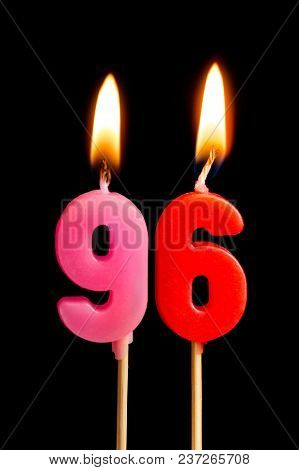 Burning Candles In The Form Of 96 Ninety Six (numbers, Dates) For Cake Isolated On Black Background.