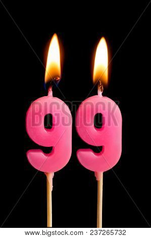 Burning Candles In The Form Of 99 Ninety Nine (numbers, Dates) For Cake Isolated On Black Background