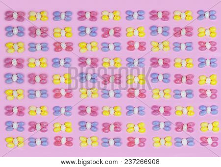 Pastel Colored Jelly Beans In A Knolling Pattern Format With A Pretty Pink Background Repeating,