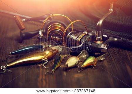 Fishing Tackle - Fishing Spinning, Hooks And Lures On Darken Wooden Background.