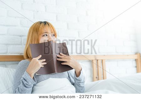 Lifestyle Happy Young Asian Woman Enjoying Lying On The Bed Reading Book Pleasure In Casual Clothing