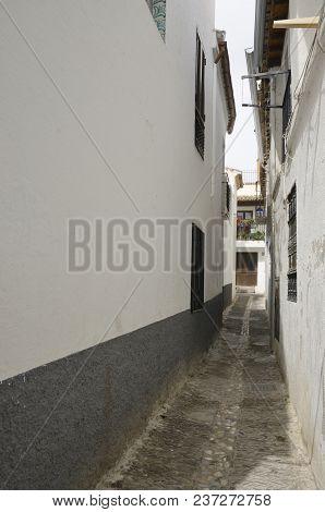 Narrow White Alley  In The Albaicin District, Granada, Andalusia, Spain.
