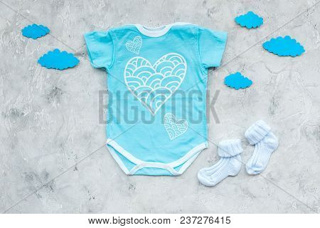 Newborn Baby's Sleep Concept. To Put The Child To Bed. Baby Bodysuit Near Clouds On Grey Background