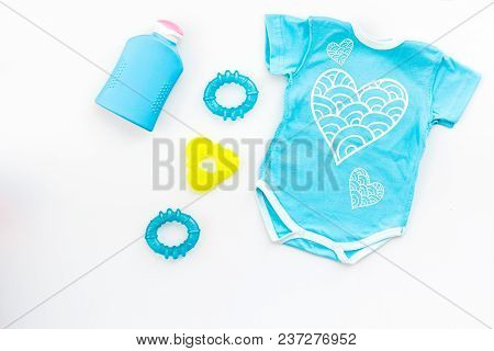 Clothes And Accessories For Newborn And Small Children On White Background Top View.