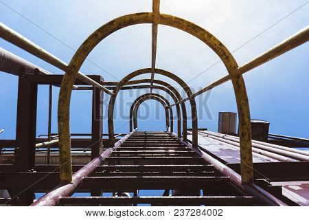 Old Industrial Ladder In To The Sky