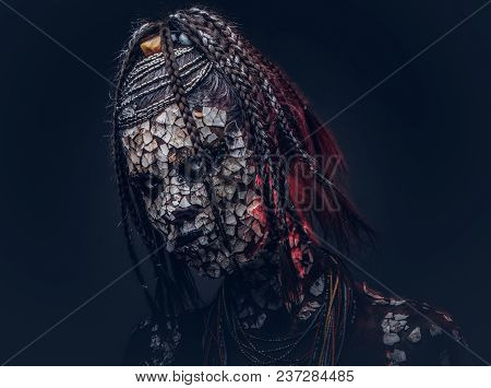 Close-up Portrait Of A Witch From The Indigenous African Tribe, Wearing Traditional Costume. Make-up