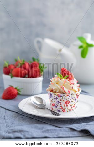 Homemade Muffins Or Cupcakes With Vanilla Cream And Fresh Strawberries On The Light Grey Background,