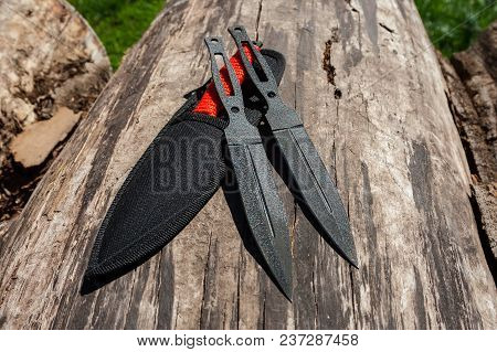 Photo Of A Throwing Knife On A Wooden Background. Stainless Steel Knife