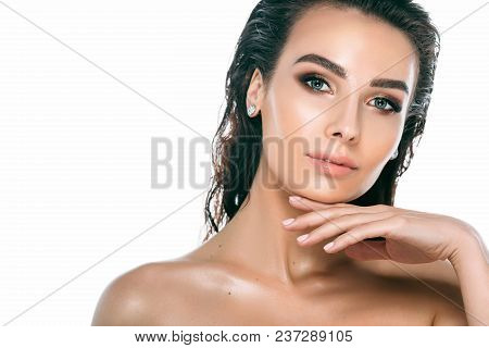 Beauty Woman Portrait. Beautiful Brunette Woman With Perfect Fresh Clean Skin And Wet Hair Posing An