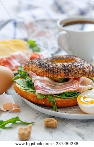 Bagel With A Salad Of Arugula,cucumber And Bacon For Breakfast.