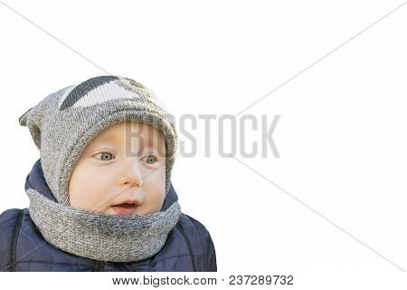 Boy In Winter Clothes With Warm Hat And Scarf Isolated On White Background