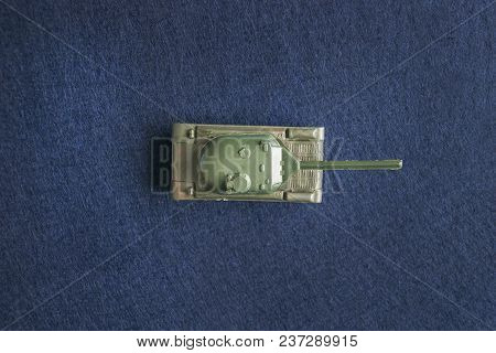 Top View Of Small Plastic Miniature Of Army Tank. Battle Or War Conceptual Image. Isolated On Dark B
