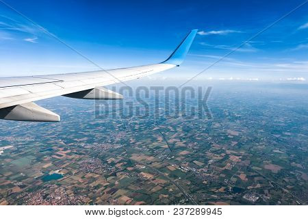 Wing Of An Airplane Flying Above The Land