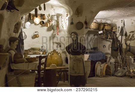 Matera, Italy - August 24 2017: Old Cavern House In Materia, Reconstruction Of How Families Lived In