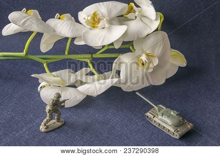 Scale Models Of Soldier Battle Scene With Moving Tank And Branch Of Orchid As Symbol . Stop War Conc