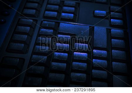 Black Keyboard Of A Personal Desktop Computer With Selective Focus And Blurred Background.