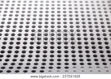 Abstract Light Colored Surface With Holes Built In A Row For Creativity And Backgrounds.