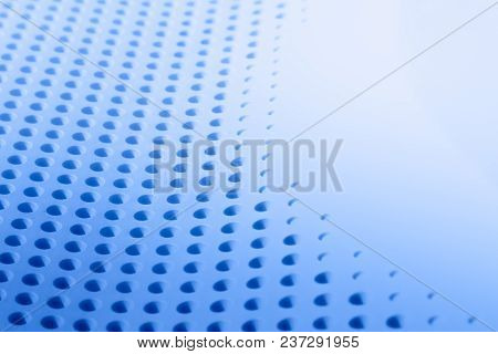 Abstract Light Colored Surface With Holes Built In A Row For Creativity, And Backgrounds.