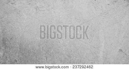 Abstract Grunge Grey Stucco Texture For Design. Rough Plaster Surface Wall Building Background. Wide