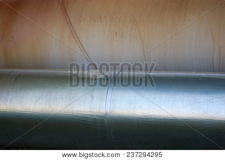 Two Large Pipes In Isolation From Tin On The Oil Refinery, Petrochemical, Chemical Plant Background,